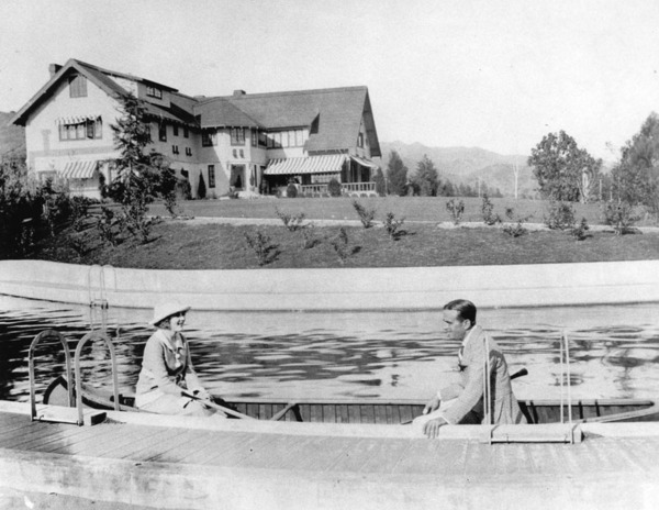 Mary Pickford and Douglas Fairbanks canoeing in the swimming pool at Pickfair. Courtesy of the Los Angeles Public Library