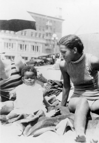 Verna with the child of a friend, Irma, at the segregated section of Santa Monica beach known as the Ink Well, 1931 | Shades of L.A. Collection, Los Angeles Public Library