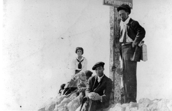 Caption reads: ''A group at the sign that reads 'Prohibited,' at the boundary between Ink Well Beach and the whites-only section of beach in Santa Monica'', ca. 1925. *This caption, which accompanied the donation of the photo, may be inaccurate. See note below, from historian Alison Rose Jefferson   Shades of L.A. Collection, Los Angeles Public Library