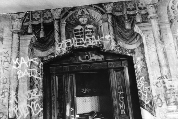 Interior view of the Talmud Torah Synagogue in Boyle Heights, showing handpainted muraled walls now covered with graffiti   Photo: Gary Leonard Collection, courtesy of the Los Angeles Public Library