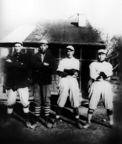 Cecil, second from left, and his brothers dressed to play baseball in Irwindale in the 1920's   Shades of L.A. Collection, Los Angeles Public Library
