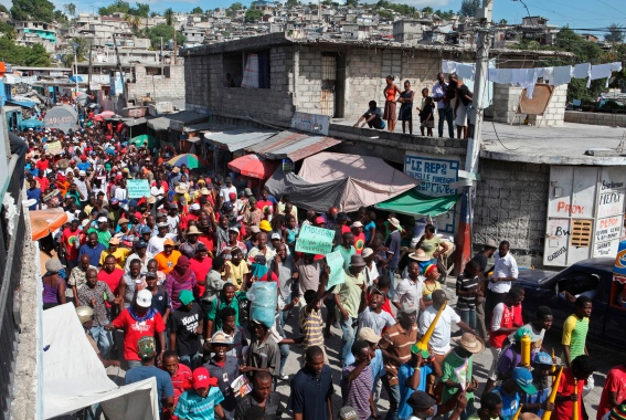 Demonstrators march through the streets during an anti-government protest in Port-au-Prince