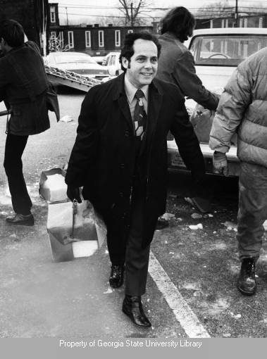 Mayor Sam Massell delivering goods to residents during a 1973 ice storm