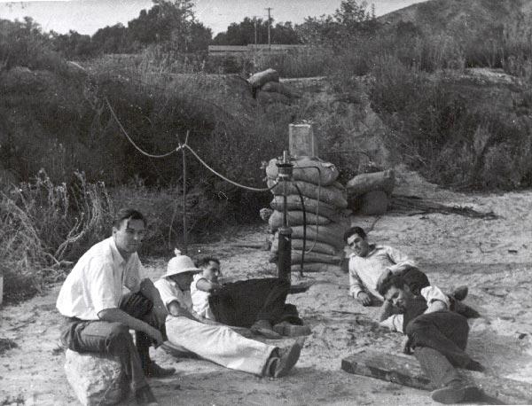 Rocket engine experimenters take a break. Rudolph Schott, Apollo Milton Olin Smith, Frank Malina (white shirt, dark pants), Ed Forman and Jack Parsons (right, foreground). Nov. 15, 1936 | Photo: JPL/NASA