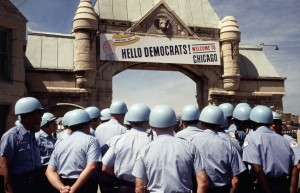 26 Aug 1968, Chicago, Illinois, USA --- The sign over the archway leading to the International Amphitheater welcomes delegates to the Democratic Convention, but from the sea of police helmets in the foreground, it looks like only police are attending. (Sign says