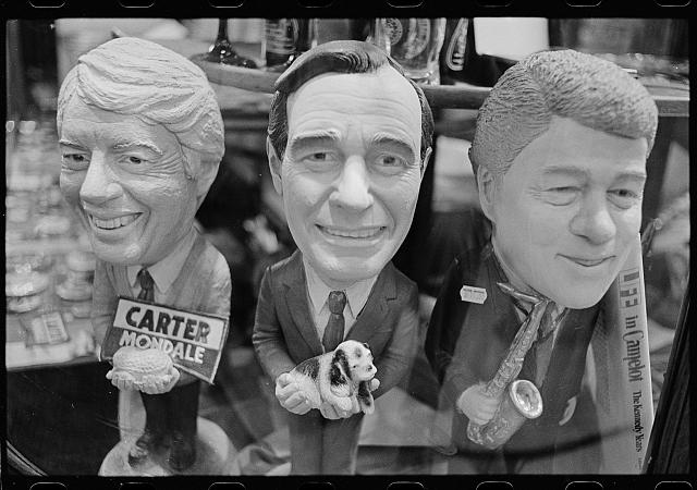 "Under President's Bush and Clinton, privatization of the military would reach new heights. ""Bobblehead dolls of presidents Jimmy Carter, George H. W. Bush and Bill Clinton in the store Political Americana, Washington, D.C."", photograph by Chris Martin, 1993 courtesy of Prints and Photographs Division, Library of Congress"
