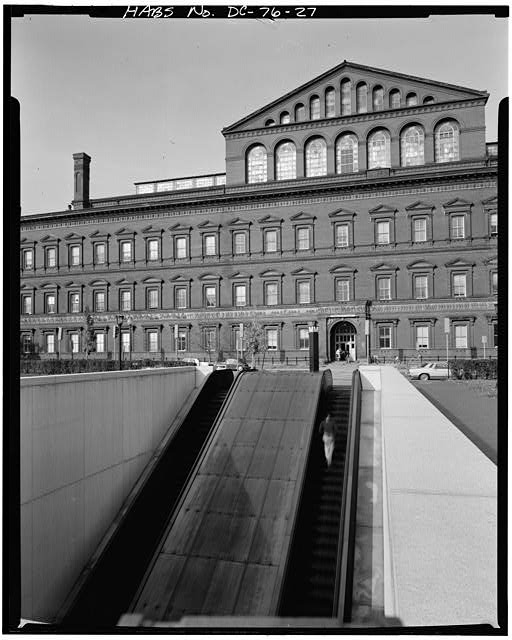 DETAIL, SOUTH FACADE, CENTRAL SECTION (ESCALATORS TO METRO SUBWAY IN FOREGROUND) - Pension Building, 440 G Street Northwest, Washington, District of Columbia, DC, Historic American Buildings Survey, Prints and Photographs Division, Library of Congress
