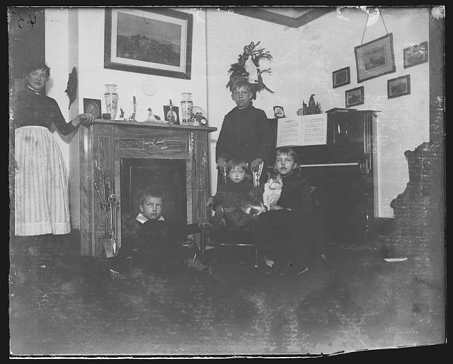 """Richmond Hill, the parlor - flash-light"", the Riis children in the Richmond Hill home, circa 1890-1904, Prints and Photographs Division, Library of Congress"
