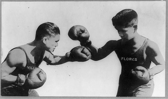 """One of Manny Pacquiao's most notable precursors, Flyweight Champion Francisco """"Pancho Villa"""" Guilledo; [Fly weight boxing champion of the world, Pancho Villa, on the left, boxing with Flores, Philippine Islands], circa 1890-1923, Frank and Frances Carpenter Collection, Prints and Photographs Division, Library of Congress"""