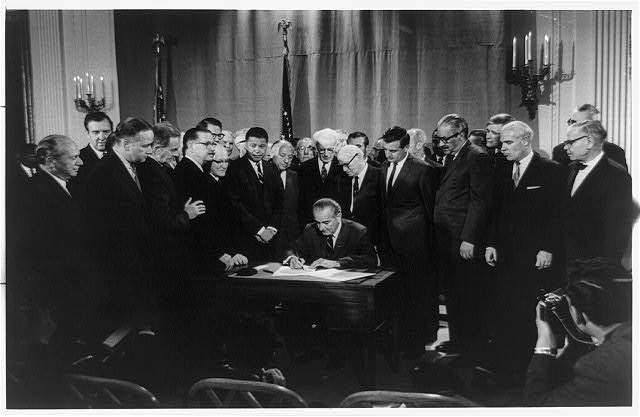 Warren K. Leffler, Lyndon Baines Johnson signing Civil Rights Bill, April 11, 1968, U.S. News and World Report Collection, Prints and Photographs, Library of Congress