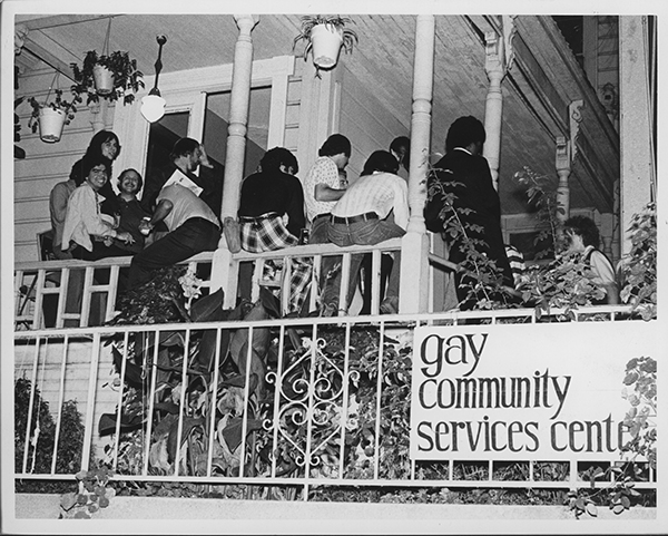 Crowd on the porch of the Gay Community Service Center.Circa 1971. Photo courtesy of Walter 'Butterfly' Blumoff Papers and Photographs, 1991-22, Gay, Lesbian, Bisexual, Transgender Historical Society.