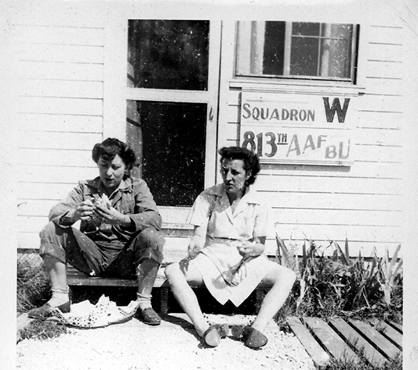 Two unidentified Women's Army Corps (WACS) servicewomen eating outside. Circa 1945.