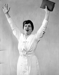 Aimee Semple McPherson, arms raised. Courtesy of Prints and Photographs Division, Library of Congress.