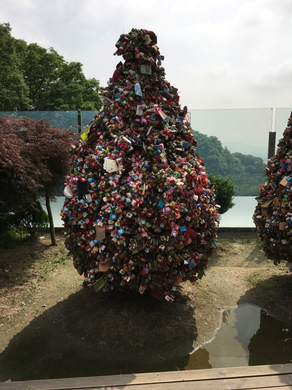 When you reach the summit you'll find a whole look out tower complex replete with Christmas trees filled with locks declaring a couple's love for one another.