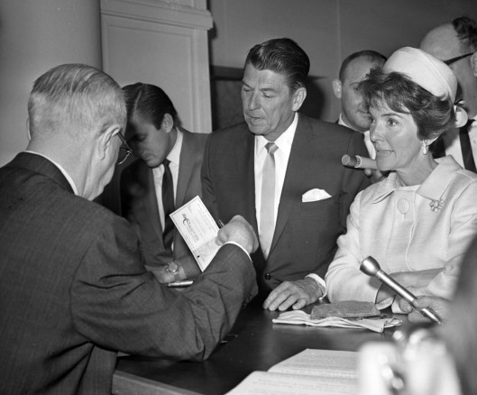 Ronald Reagan with his wife Nancy, filing the papers to run for governor in 1966. Photo by Benjamin Hite, courtesy of the Los Angeles Times Photographic Archive, UCLA Library.