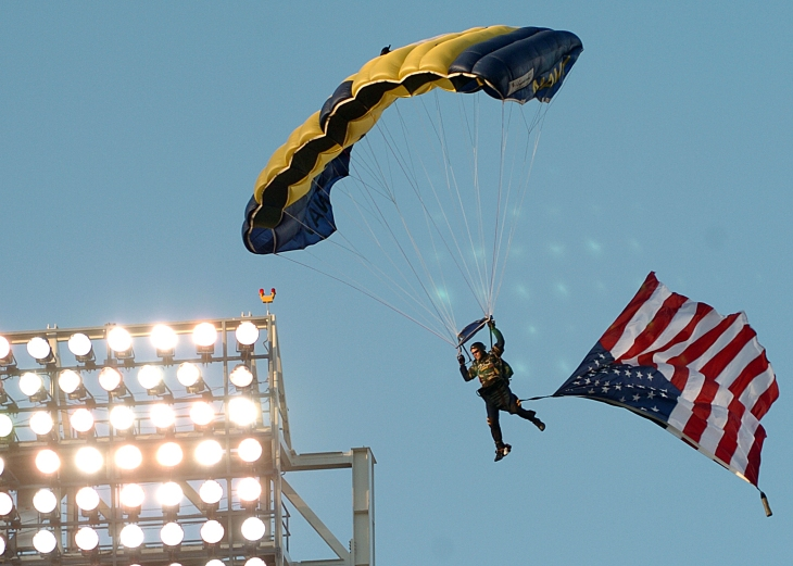 "050420-N-8977L-004 San Diego, Calif. (April 20, 2005) Ð A Member of the U.S. Navy Parachute Team, the ""Leap Frogs,"" descends into San Diego's Petco Park as part of opening ceremonies for the San Diego Padres' Military Appreciation Day. The events preceded a game between the Padres and the Los Angeles Dodgers. U.S. Navy photo by PhotographerÕs Mate 2nd Class Johansen Laurel (RELEASED)"