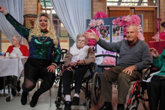 drag queen waving at senior center